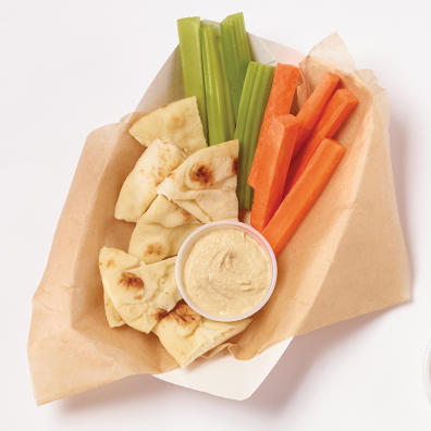 Disposable hummus tray with veggies and pita
