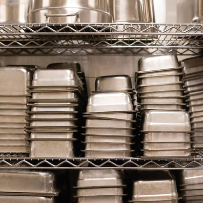Kitchen pans on storage rack